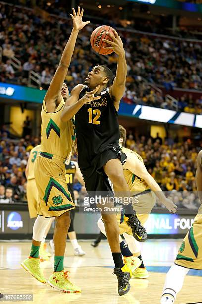 Darius Carter of the Wichita State Shockers drives to the basket against Bonzie Colson of the Notre Dame Fighting Irish in the first half during the...