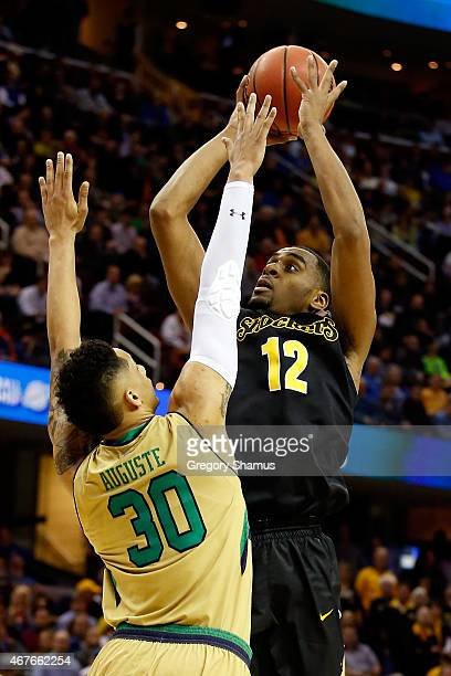 Darius Carter of the Wichita State Shockers shoots against Zach Auguste of the Notre Dame Fighting Irish in the first half during the Midwest...