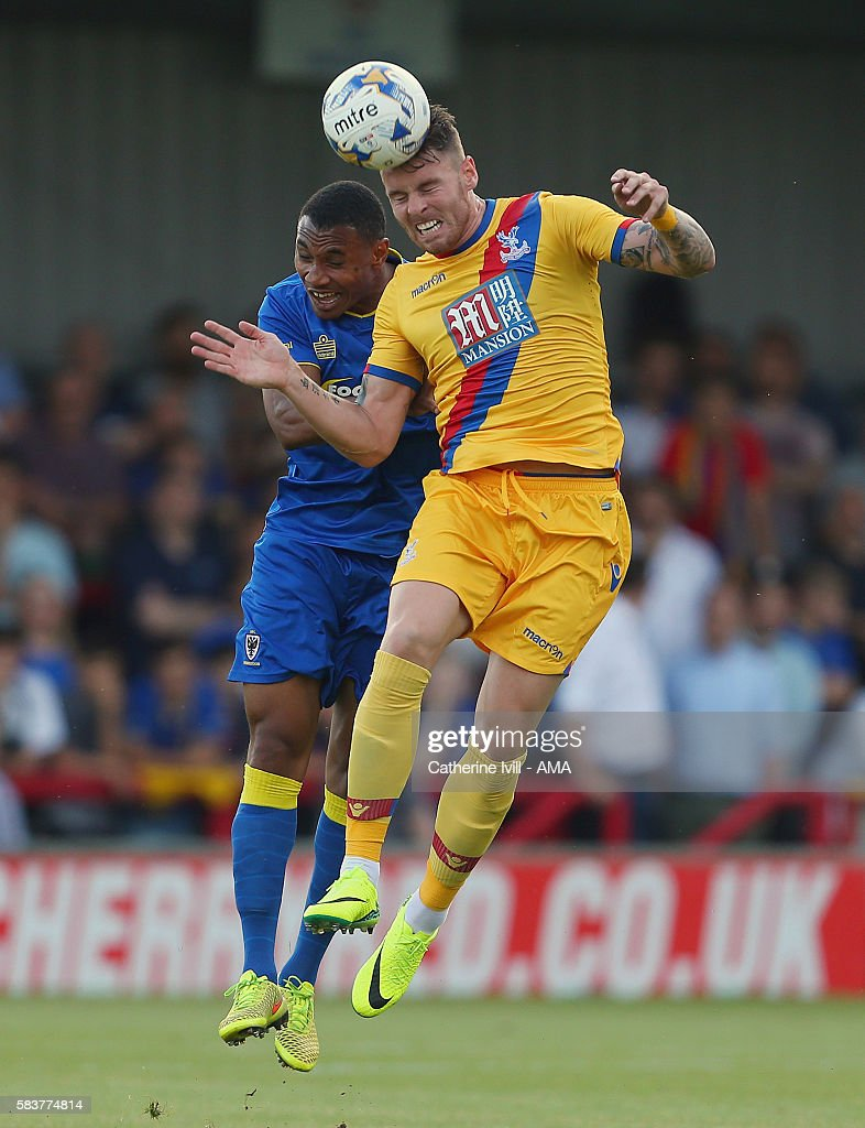 Darius Charles of AFC Wimbledon and Connor Wickham of Crystal Palace during the Pre-Season Friendly match between AFC Wimbledon and Crystal Palace at The Cherry Red Records Stadium on July 27, 2016 in Kingston upon Thames, England.