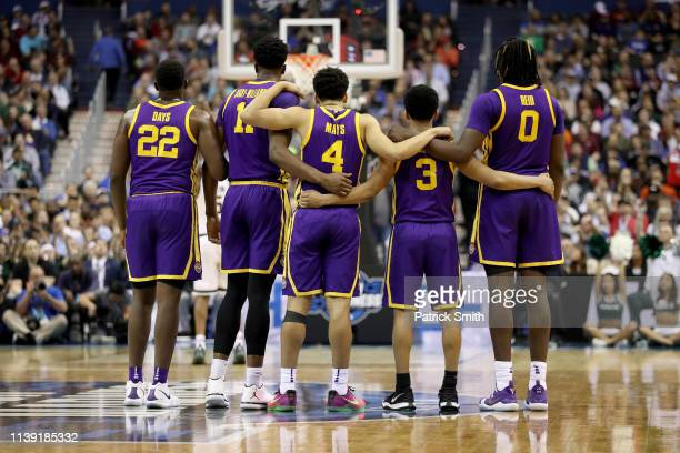 Darius Days Kavell BigbyWilliams Skylar Mays Tremont Waters and Naz Reid of the LSU Tigers huddle together against the Michigan State Spartans during...