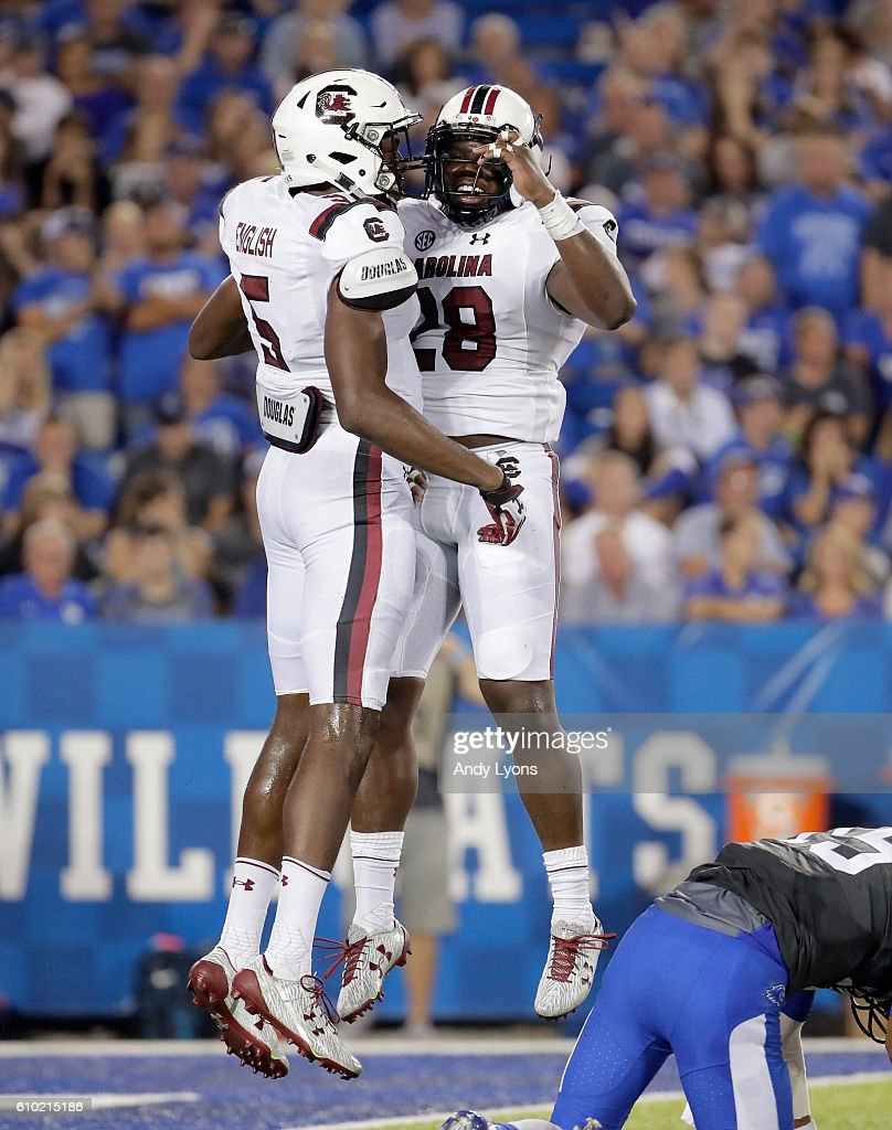 Darius English #5 and Jonathan Walton #28 of the South Carolina Gamecocks celebrate a defensive stop against the Kentucky Wildcats at Commonwealth Stadium on September 24, 2016 in Lexington, Kentucky.