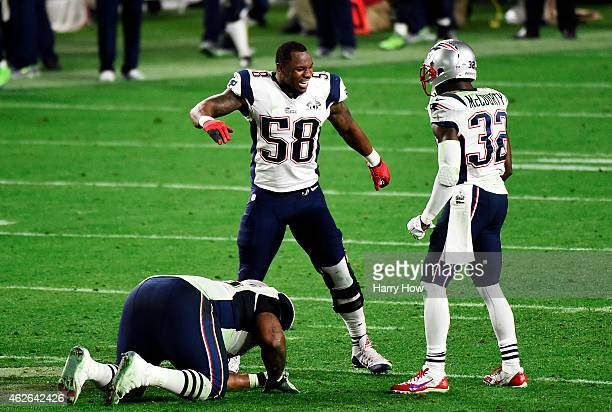 Darius Fleming and Devin McCourty of the New England Patriots react after an interception against the Seattle Seahawks in the fourth quarter during...