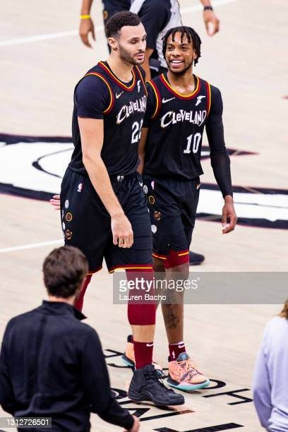 Darius Garland congratulates Larry Nance Jr. #22 of the Cleveland Cavaliers after Nance scored a three point basket during the third quarter of a...