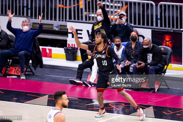 Darius Garland of the Cleveland Cavaliers celebrates after making a three point basket during the second quarter of a game against the Golden State...