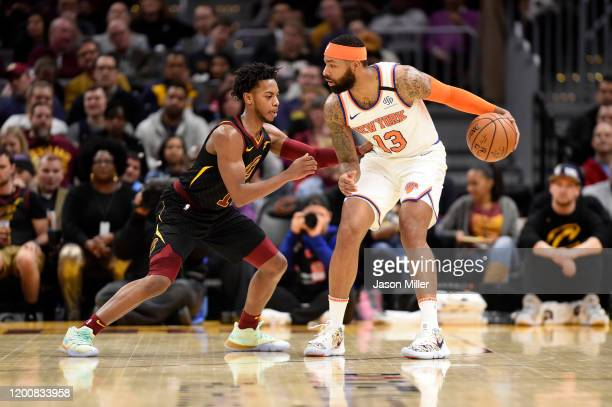 Darius Garland of the Cleveland Cavaliers guards Marcus Morris Sr #13 of the New York Knicks during the second half at Rocket Mortgage Fieldhouse on...