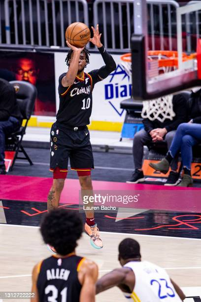 Darius Garland of the Cleveland Cavaliers shoots a three pointer during the second quarter of a game against the Golden State Warriors at Rocket...