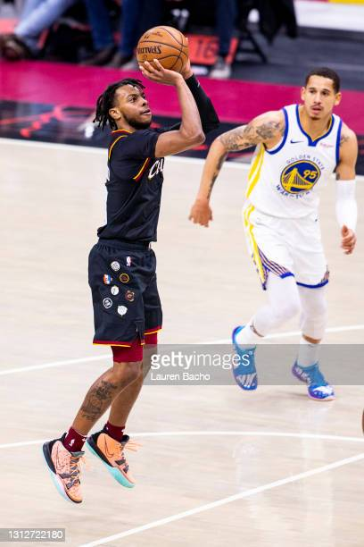 Darius Garland of the Cleveland Cavaliers shoots the ball during the second quarter of a game against the Golden State Warriors at Rocket Mortgage...