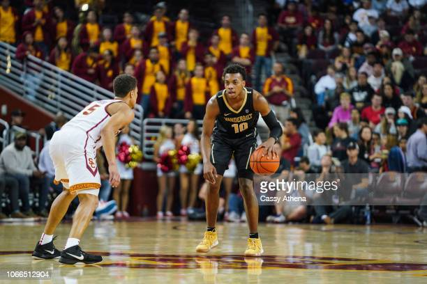 Darius Garland of the Vanderbilt Commodores handles the ball against Derryck Thornton of the USC Trojans during a game at The Galen Center on...