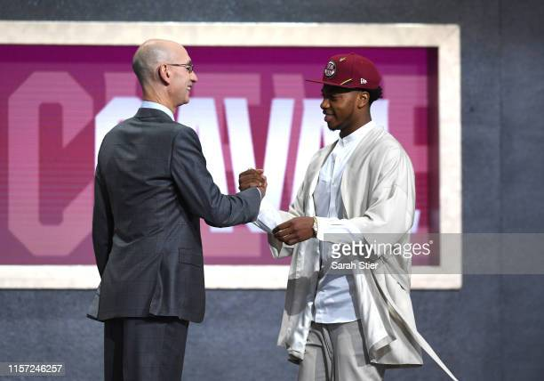 Darius Garland poses with NBA Commissioner Adam Silver after being drafted with the fifth overall pick by the Cleveland Cavaliers during the 2019 NBA...