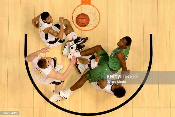 Darius George of the Marshall Thundering Herd lies on the ground after his shot against James Bolden, Logan Routt, Lamont West and Daxter Miles Jr....