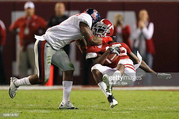 Darius Hanks of the Alabama Crimson Tide is slammed down on a tackle by Marcus Temple of the Ole Miss Rebels at Bryant-Denny Stadium on October 16,...