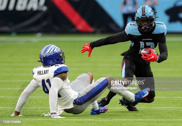Darius Hillary of the St. Louis Battlehawks slips on the turf as he tries to stop the run by Jeff Badet of the Dallas Renegades in the first half of...