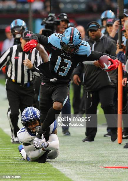 Darius Hillary of the St. Louis Battlehawks tackles Jeff Badet of the Dallas Renegades in the first half of an XFL Football game on February 09, 2020...