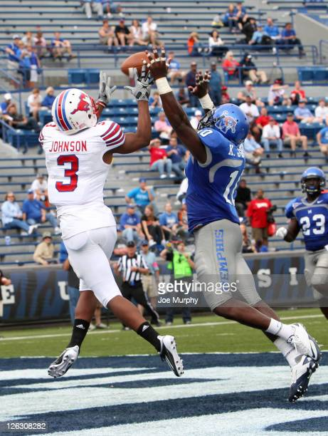 Darius Johnson of the SMU Mustangs catches a touchdown pass against Kenyata Johnson of the Memphis Tigers on September 24, 2011 at Liberty Bowl...