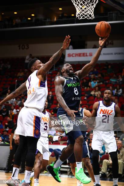 Darius JohnsonOdom of the Iowa Wolves lays up a shot against Derek Cooke Jr #11 of the Northern Arizona Suns in an NBA GLeague game on December 1...