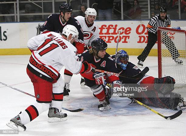 Darius Kasparaitis and goaltender Kevin Weekes of the New York Rangers defend on the shot from right winger Justin Williams of the Carolina...