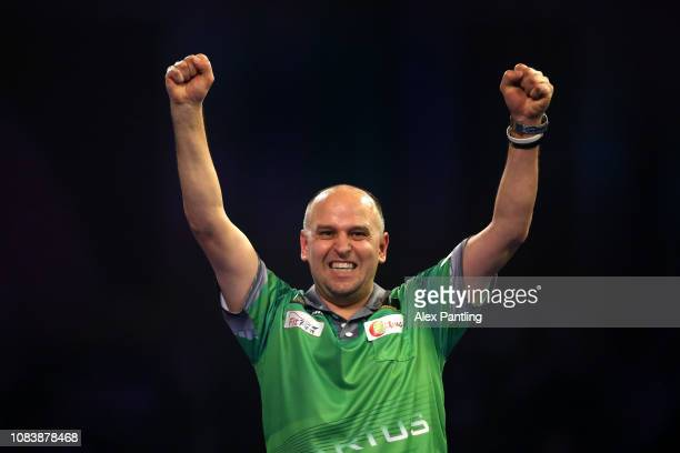 Darius Labanauskas of Lithuania celebrates victory during his first round match against Raymond van Barneveld of the Netherlands during Day five of...