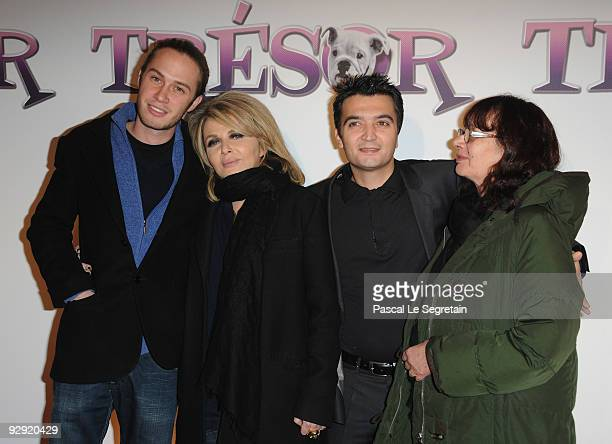 Darius Langmann Nathalie Rheims Thomas Langmann and Arlette Langmann pose as they attend the premiere of the directors Claude Berry and Francois...
