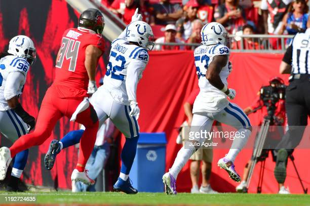 Darius Leonard of the Indianapolis Colts scores after picking off Jameis Winston of the Tampa Bay Buccaneers during the second quarter of a football...
