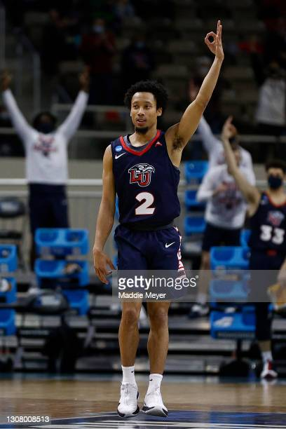 Darius McGhee of the Liberty Flames celebrates after a three point basket against the Oklahoma State Cowboys during the first half in the first round...