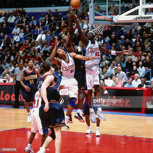 Darius Miles and Corey Maggette of the Los Angeles Clippers goes up for a rebound against the Denver Nuggets on January 10 2001 at Staples Center in...