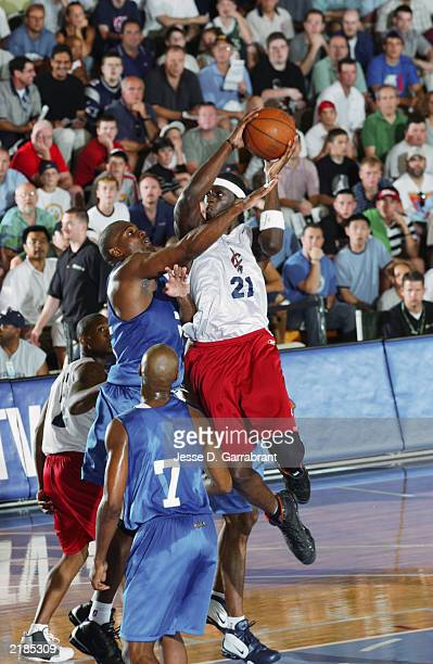 Darius Miles of the Cleveland Cavaliers goes to the basket against Derek Hood of the Dallas Mavericks during the Reebok Pro Summer League on July 17...