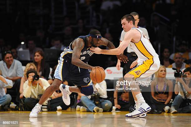 448cc26be Darius Miles of the Memphis Grizzlies drives against Adam Morrison of the Los  Angeles Lakers at