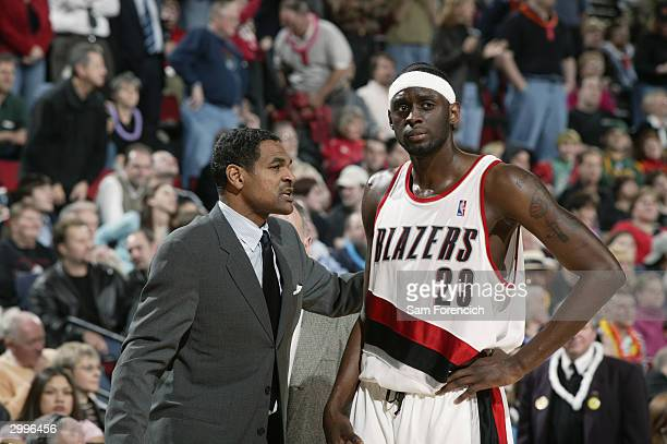 Darius Miles of the Portland Trail Blazers listens to head coach Maurice Cheeks during the game against the Utah Jazz at Rose Garden on February 10...