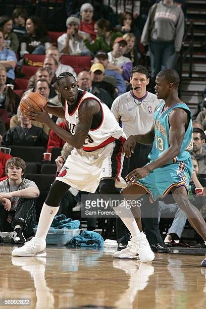 Darius Miles of the Portland Trail Blazers looks to pass the ball against Linton Johnson III of the New Orleans/Oklahoma City Hornets February 26,...