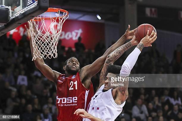 Darius Miller of Brose Bamberg defends against Julian Gamble of Telekom Baskets Bonn during the BBL Bundesliga match between Telekom Baskets Bonn and...