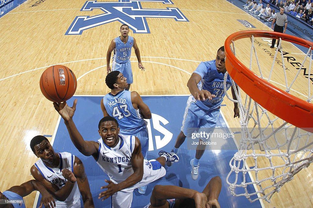 Darius Miller #1 of the Kentucky Wildcats goes up for a shot past John Henson #31 of the North Carolina Tar Heels at Rupp Arena on December 3, 2011 in Lexington, Kentucky. Kentucky won 73-72.