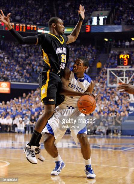 Darius Miller of the Kentucky Wildcats shoots the ball while defended by Larry Anderson of the Long Beach State 49ers during the game at Rupp Arena...