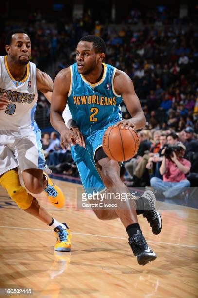 Darius Miller of the New Orleans Hornets drives to the basket against Andre Iguodala of the Denver Nuggets on February 1 2013 at the Pepsi Center in...