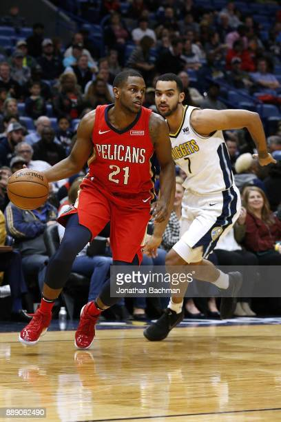 Darius Miller of the New Orleans Pelicans drives against Trey Lyles of the Denver Nuggets during the first half of a game at the Smoothie King Center...