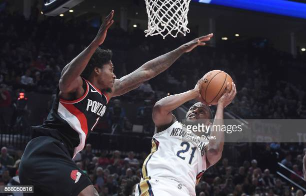 Darius Miller of the New Orleans Pelicans drives to the basket on Ed Davis of the Portland Trail Blazers during the first quarter of the game at Moda...