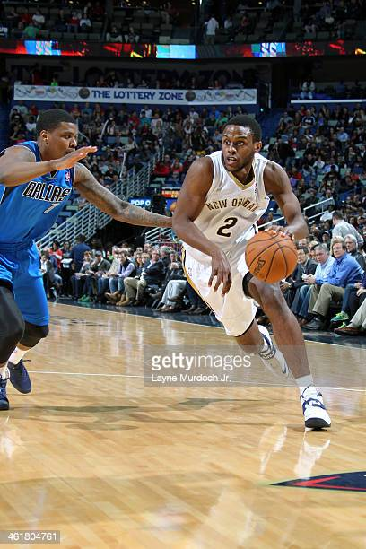 Darius Miller of the New Orleans Pelicans drives to the basket against the Dallas Mavericks on January 10 2014 at the New Orleans Arena in New...