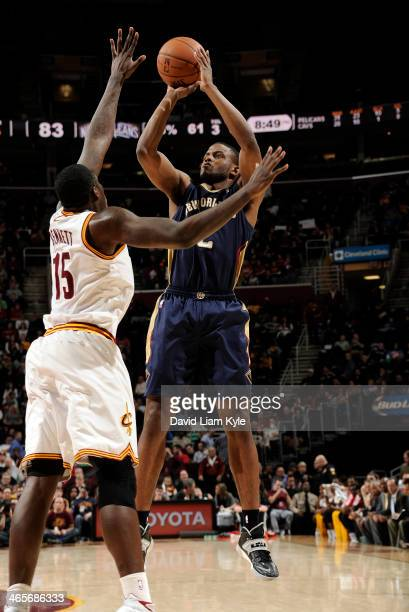 Darius Miller of the New Orleans Pelicans goes up for the shot against Anthony Bennett of the Cleveland Cavaliers at The Quicken Loans Arena on...