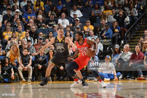 Darius Miller of the New Orleans Pelicans handles the ball against the Golden State Warriors on November 25 2017 at ORACLE Arena in Oakland...