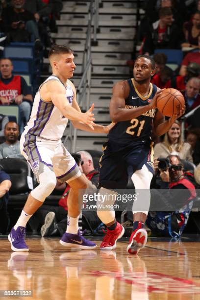 Darius Miller of the New Orleans Pelicans passes the ball against Bogdan Bogdanovic of the Sacramento Kings on December 8 2017 at Smoothie King...
