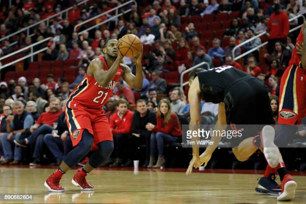 Darius Miller of the New Orleans Pelicans shoots a three point shot defended by Ryan Anderson of the Houston Rockets in the second half at Toyota...