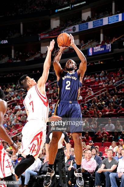 Darius Miller of the New Orleans Pelicans shoots against the Houston Rockets on April 12 2014 at the Toyota Center in Houston Texas NOTE TO USER User...