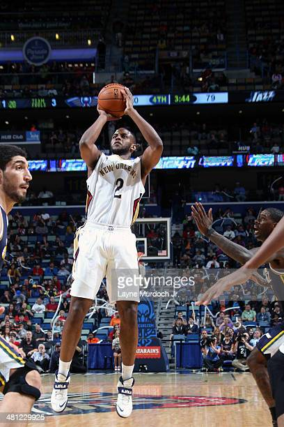 Darius Miller of the New Orleans Pelicans shoots against the Utah Jazz on March 28 2014 at the Smoothie King Center in New Orleans Louisiana NOTE TO...