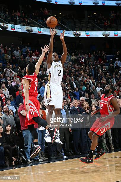 Darius Miller of the New Orleans Pelicans shoots the ball against the Houston Rockets during an NBA game on January 15 2014 at the New Orleans Arena...