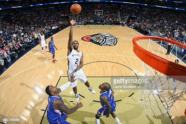 Darius Miller of the New Orleans Pelicans shoots the ball against the Los Angeles Clippers during an NBA game on March 26 2014 at the Smoothie King...