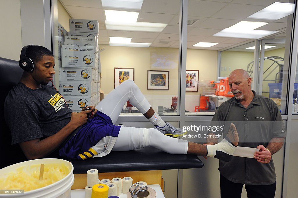 Darius Morris #1 of the Los Angeles Lakers gets taped before the game against the Miami Heat at Staples Center on January 17, 2013 in Los Angeles, California.