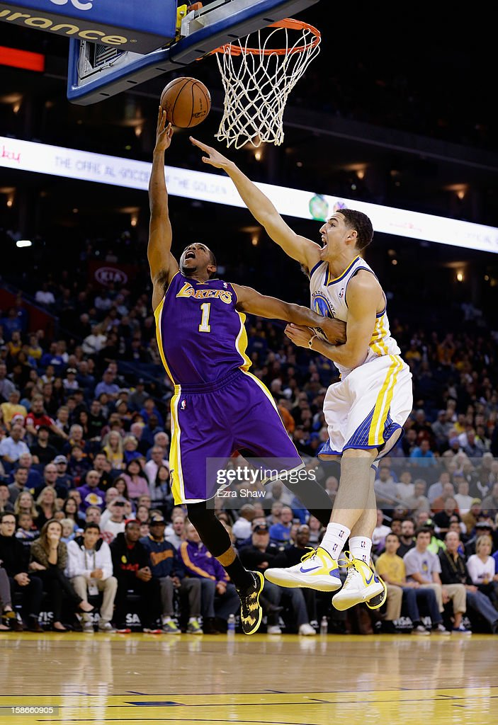 Darius Morris #1 of the Los Angeles Lakers goes up for a shot on Klay Thompson #11 of the Golden State Warriors at Oracle Arena on December 22, 2012 in Oakland, California.