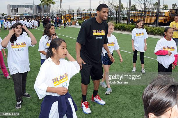 """Darius Morris of the Los Angeles Lakers interacts with young fans as the Los Angeles Lakers and Anthem Blue Cross as part of """"Fit for Life with the..."""