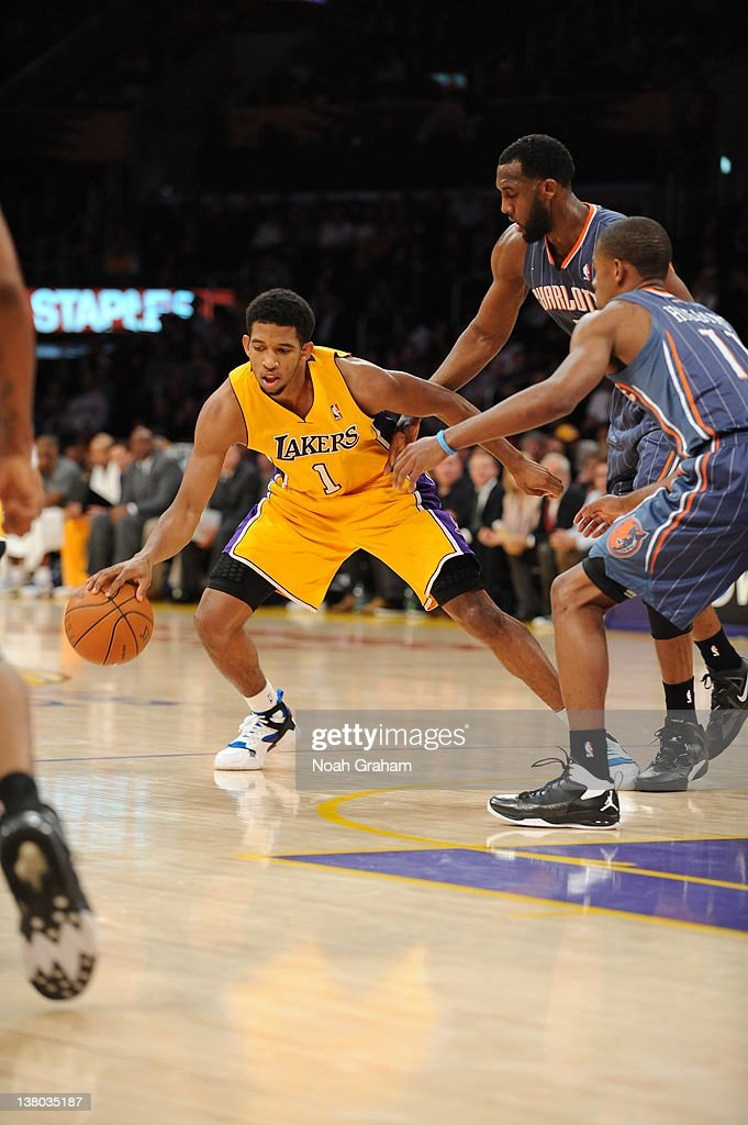 Darius Morris #1 of the Los Angeles Lakers protects the ball during the game between the Los Angeles Lakers and the Charlotte Bobcats at Staples Center on January 31, 2012 in Los Angeles, California.