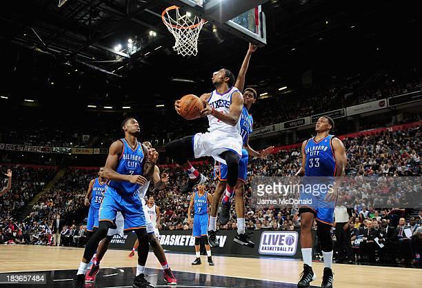Darius Morris of the Philadelphia 76ers scores a basket during the NBA pre season match between Oklahoma City Thunder and Philadelphia 76ers at...