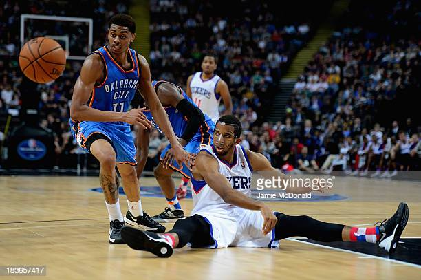 Darius Morris of the Philadelphia 76ers tussles with Jeremy Lamb of the Oklahoma City Thunder during the NBA pre season match between Oklahoma City...